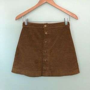 American Apparel snap front mini skirt